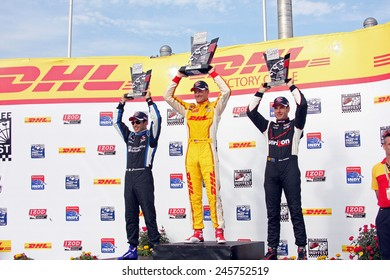 Milwaukee Wisconsin, USA - June 15, 2013: Indycar Indyfest 225 race Milwaukee Mile. Victory Circle celebration. 1st Ryan Hunter-Reay,2nd Helio Castroneves,3rd Will Power RC cap