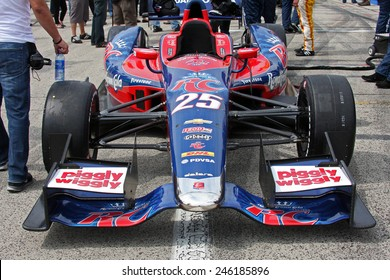 """Milwaukee Wisconsin, USA - June 15, 2013: Indycar Indyfest race Milwaukee Mile. Pre-race pit lane grid """"The Mile"""" oval. Marco Andretti close up of sponsors and team logos. Royal Crown RC Cola"""