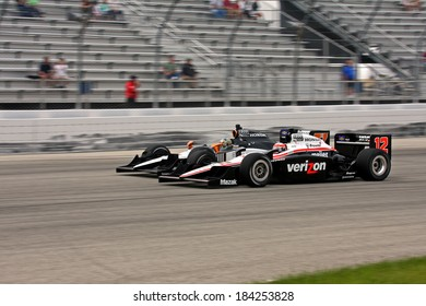 MILWAUKEE, WISCONSIN, USA - JUNE 19, 2011: No.  12 Will Power, Australia Team Penske side by side action with 77 Alex Tagliani, Canada Sam Schmidt Motorsports