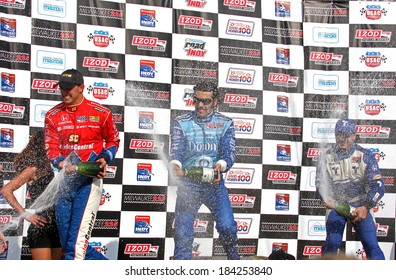 MILWAUKEE, WISCONSIN, USA - JUNE 19, 2011:  Champagne celebration, 2nd Graham Rahal, 1st Dario Franchitti, 3rd Oriol Servia