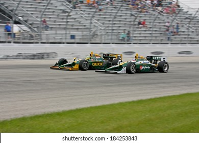 MILWAUKEE, WISCONSIN, USA - JUNE 19, 2011: No.  82 Tony Kanaan, Brazil and teammate 5 Takuma Sato, Japan KV Racing Technology - Lotus