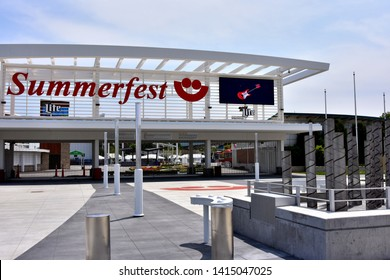 Milwaukee, Wisconsin / USA - June 3, 2019: The Summerfest main entrance with guitar on large monitor.