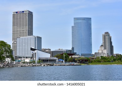 Milwaukee, Wisconsin / USA - June 3, 2019: The Milwaukee skyline as scene from Lakeshore State Park across from the Summerfest Grounds.