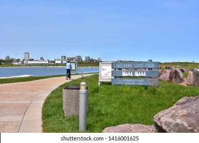 Milwaukee, Wisconsin / USA - June 3/2019: People enjoying the warm spring day in Lakeshore State Park along the coast of Lake Michigan.