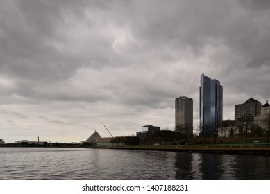 Milwaukee, Wisconsin / USA - May 25, 2019: The Milwaukee skyline with stormy clouds above on the Saturday before Memorial Day.