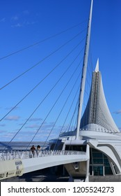Milwaukee, Wisconsin / USA - October 17, 2018: The Beautiful Calatrava designed Milwaukee Art Museum on a sunny day with a few clouds in the distant sky.  The wings are in the closed position.