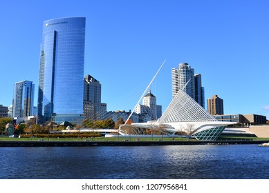 Milwaukee, Wisconsin / USA - October 17, 2018:  The Calatrava designed architecture of the Milwaukee Art Museum with the Northwestern Mutual building filling the sky in this cityscape.