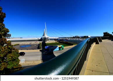 Milwaukee, Wisconsin / USA - October 17, 2018:  The Calatrava designed architecture of the Milwaukee Art Museum in the background with a long handrail in the foreground.