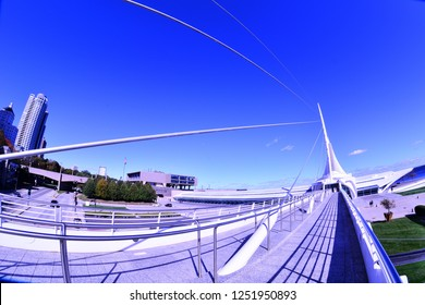 Milwaukee, Wisconsin / USA - October 17, 2018:  The Calatrava designed architecture of the Milwaukee Art Museum with the artistic supporting cables leading to the tower.  Special effects with fisheye.