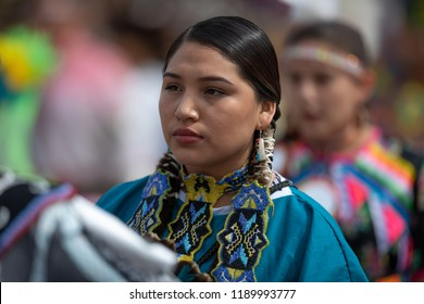 Milwaukee, Wisconsin, USA - September 8, 2018 The Indian Summer Festival Young woman wearing traditional native american clothing at the pow wow competition.