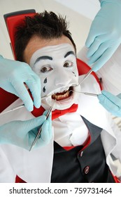 Mim with a dental retractor in the mouth in the dental clinic. Toothache, dental caries, dentist's fear