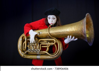 MIM holds a musical pipe