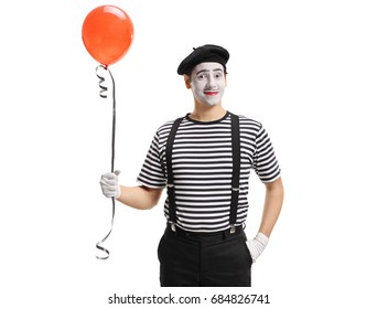 Mime artist with a balloon isolated on white background