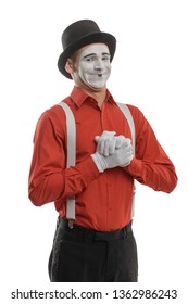 Mime artist with cunning smile and clasped hands. Man came up with an idea of prank or trick. Naughty boy, comedy sketch.