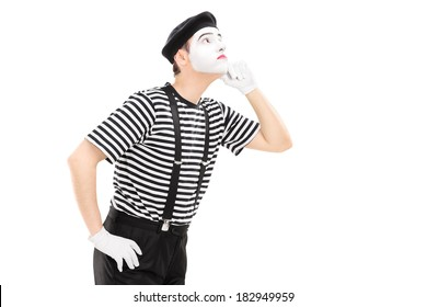 Mime artist listening something isolated on white background