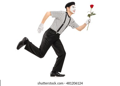 Mime artist running and holding a rose flower isolated on white background