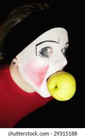 mime biting an apple