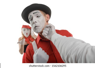 Mime got punch in the face, girl in panic. Men fight over women. Jealousy, competition concept.