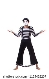 Mime with his feet chained isolated on white