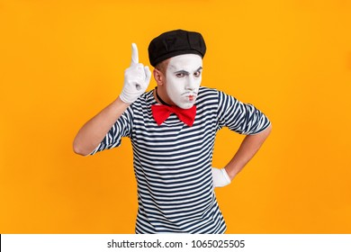 Mime man showing one finger up. Last chance