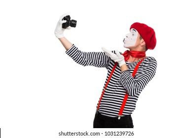mime taking selfie with film camera and sending air kiss isolated on white
