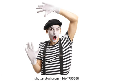 Mime toucing an imaginary wall isolated on white background