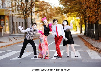 mimes on a background of autumn trees