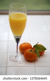 Mimosa. Champagne and Orange Juice. Oranges with Champagne Mimosa brunch.
