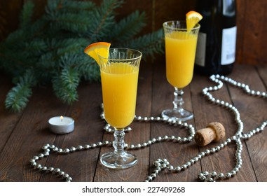 Mimosa cocktail with orange juice and champagne on Christmas background horizontal