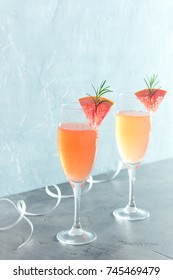 Mimosa festive drink  - Champagne cocktail Mimosa with Grapefruit and Rosemary for Christmas party, copy space