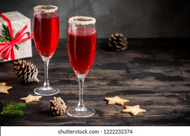 Mimosa festive drink for Christmas - champagne red cocktail Mimosa (mocktail) with cranberry for Christmas party, copy space