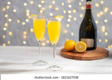 Mimosa festive drink for Christmas - Champagne cocktail Mimosa with orange juice for party, copy space