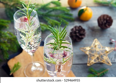 Mimosa festive drink for Christmas - champagne cocktail with rosemary for Christmas party