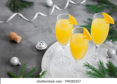 Mimosa festive drink for Christmas - Champagne cocktail Mimosa with Orange juice for Christmas party, copy space