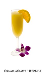 Mimosa mixed drink with orange slice and orchid garnish on a white background