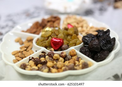 Mimouna, traditional North African Jewish feast held the day after Passover Set with traditional foods and symbols of the holiday. Sfenj or sfinj - Moroccan Doughnuts or Fritters.