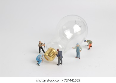min worker character as electrician with bulb