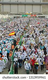 MINA, SAUDI ARABIA : Muslim pilgrims walk outside Muaisem tunnel in Mina, to do jamarat ritual as part of hajj.  Millions of muslims around the world perform hajj during this time (08/2018).