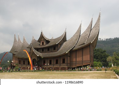 The Minangkabau royal palace at Pagaruyung has three roofs which rise in tiers; the first two rise laterally and the top room transversally. Extensions at either side add a further two roof forms.