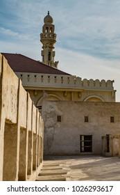 A minaret from the Al Khalifa mosque as  seen from the Al Khalifa House in Muharraq, Bahrain.