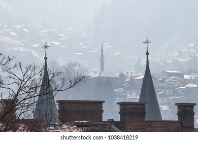 Minaret and church towers (steeples) on the hills of Sarajevo, Bosnia and Herzegovina. This city is famous for its religous coexistence