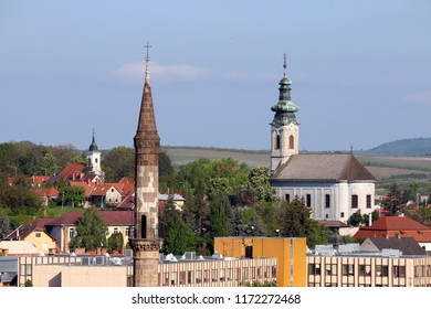 minaret and churches different religions in one city Eger Hungary