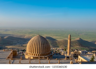 Minaret of the Great Mosque known also as Ulu Cami with mesopotamian plain in the background, Mardin, Turkey.