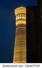 Minaret Kalyan at night. Night view of Kalyan minaret of Bukhara. One of the greatest buildings of the East. Great minaret or Minaret of Death. Covered with different shape ceramic tiles