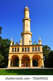 Minaret in Lednice castle park in sunny day, vertical photo