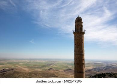 Minaret of a mosque with mesopotamia view in Mardin city, Turkey