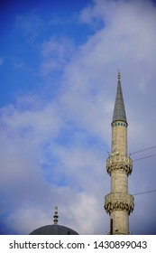 Minaret of a Muslim mosque on the background of the cloudy sky. one minaret aspiring to heaven, a religious Muslim shrine.