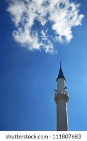 Minaret on blue sky background