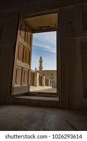 A minaret from the Shaikh Isa Bin Ali Al Khalifa Mosque is visible from the Al Khalifa house in Muharraq, Bahrain.