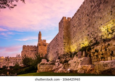 The minaret of the Tower of David/Jerusalem Citadel museum, located next to Jaffa Gate and the Ottoman-built fotrified Old City Wall with remains from earlier periods, with beautiful sunrise clouds